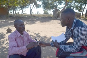 JohnPaulKauyni-interviews-groundnut-farmer-in-Mchinji---BW-writers-workshop